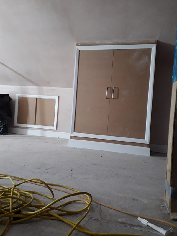 Cupboards built to gain access to flue and storage