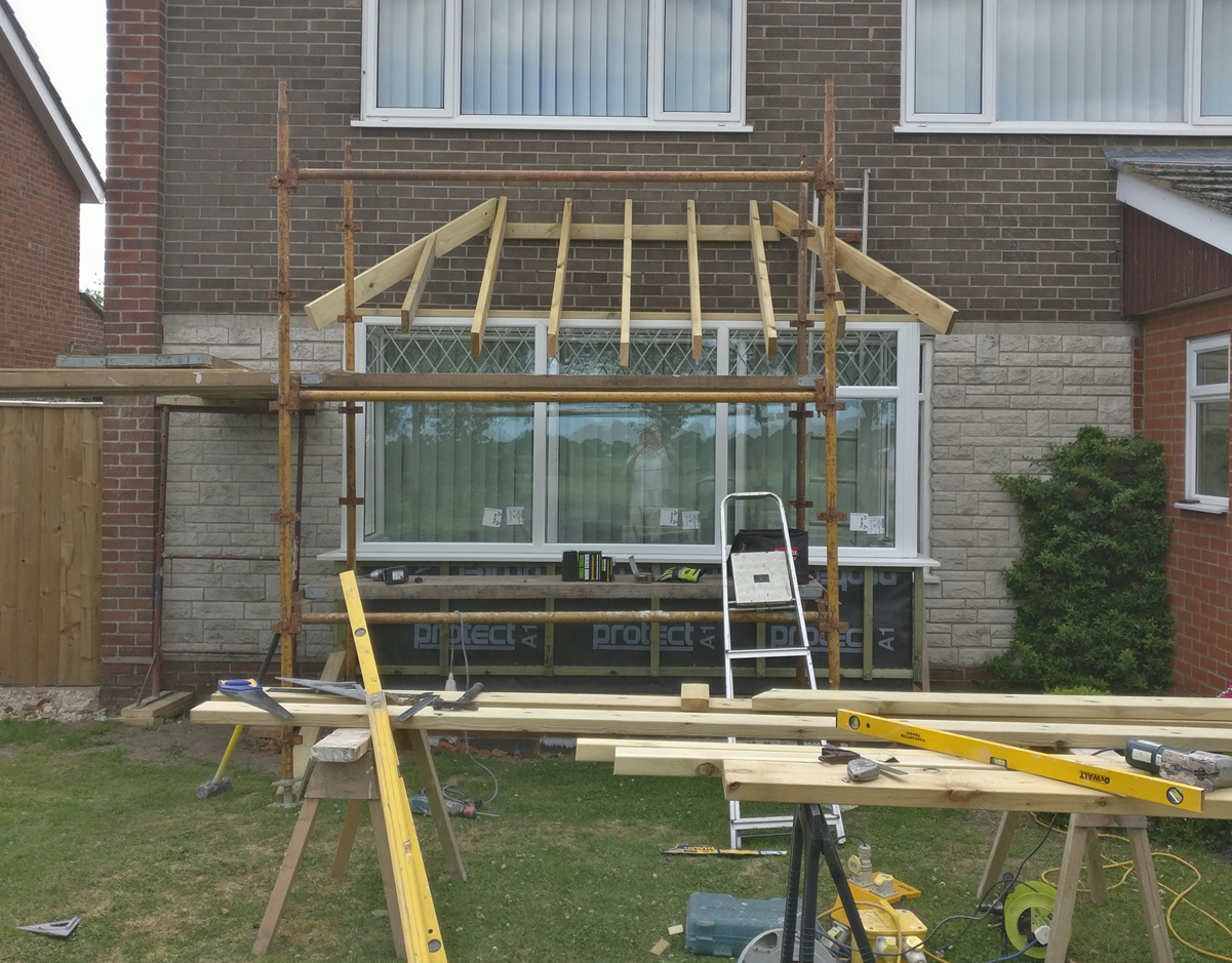 Hand cut double hipped roof