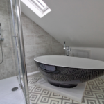 Bathroom fitted with egg shaped bath
