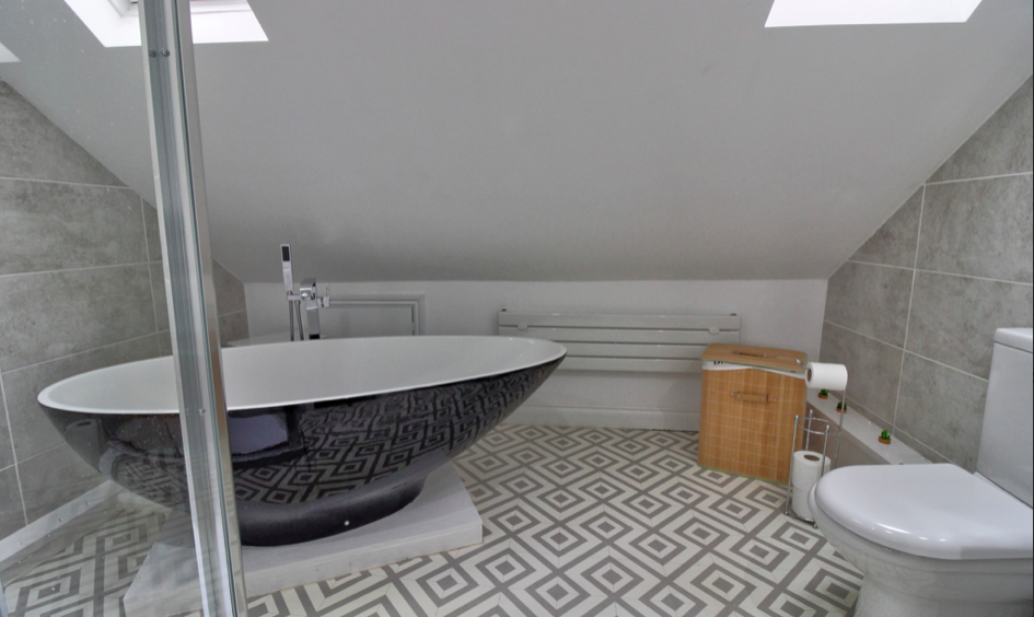 Loft conversion bathroom with velux