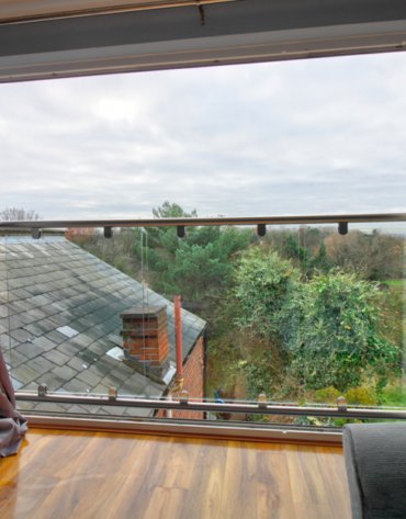 Slide and fold doors with glass balcony